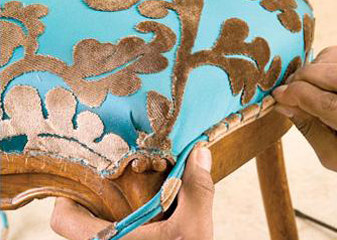 Recover your favorite chair with Arvid's Interiors custom furniture reupholstery service.